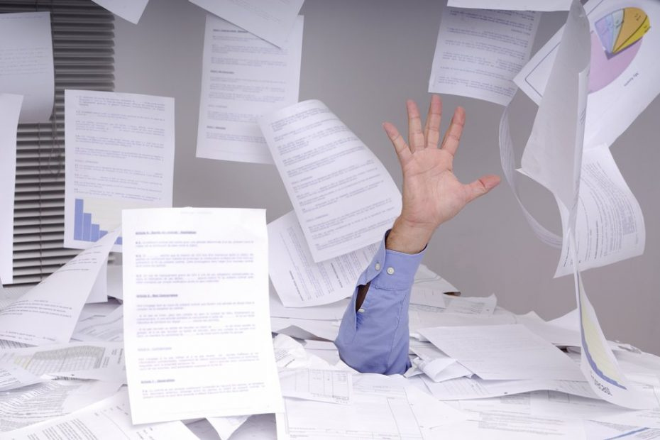Man drowning in documents